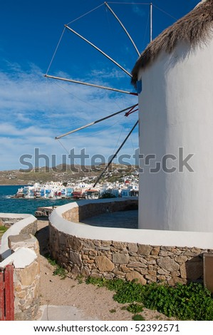 Windmill on the background of Little Venice on the island of Mykonos. The main attraction of the Greek Islands - stock photo