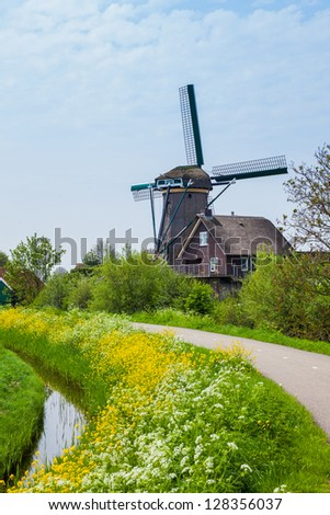 Windmill on the outskirts of Amsterdam. Holland the Netherlands. Vertical view