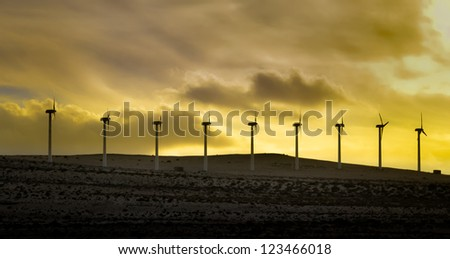 Windmill power farm on Fuerteventura island - stock photo