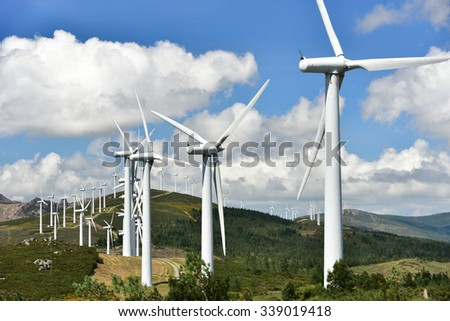 windmill-powered plant on hilltop in Europe  - stock photo