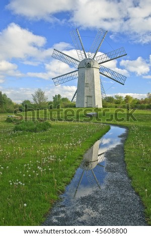 Windmill reflection in puddle