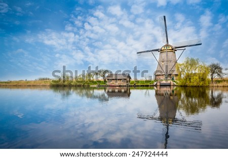Windmill reflections at Kinderdijk in Holland, Netherlands - stock photo