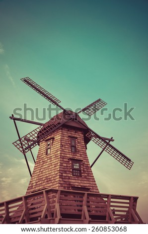 Windmill standing in the blue sky creating a nice aerial view in retro color - stock photo