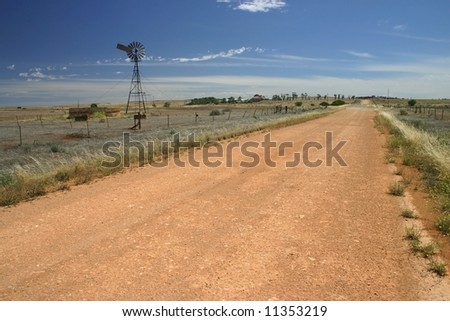 Windmill standing still in the middle of a cultivated field. South Australia - stock photo