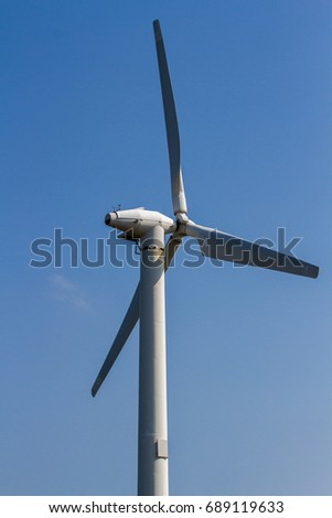 Windmill to produce electricity on blue sky background