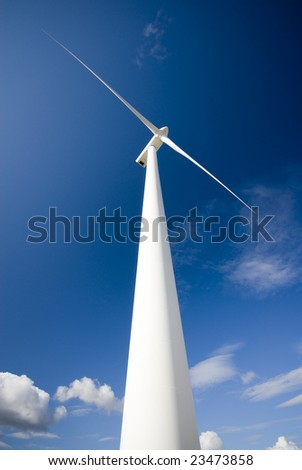 windmill with blue sky and clouds background