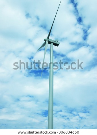Windmill with blue sky background summer