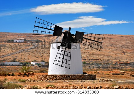 Windmill with broken wing. Agriculture crisis concept. Spain