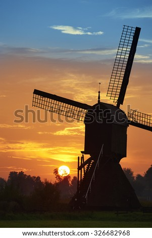 Windmill with sunset in the Netherlands - stock photo