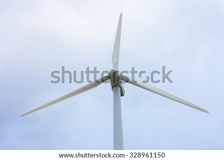 Windmill with three blades view from below. Eolic energy. Closeup and  color photography.  - stock photo