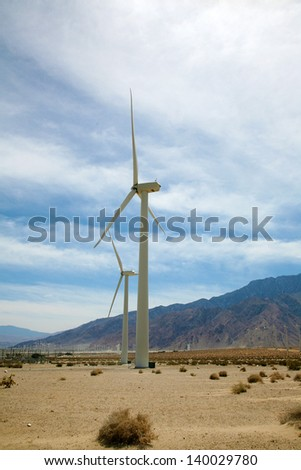 "Windmills AKA ""Wind Turbine"" or ""Wind Farm"" with windmills in the desert of Palm Springs in Southern California - stock photo"