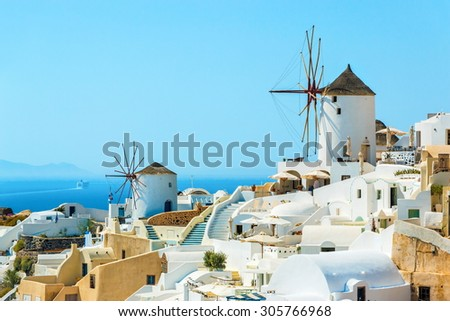 Windmills and buildings on the hill in the famous Oia town, Santorini island, Greece - stock photo