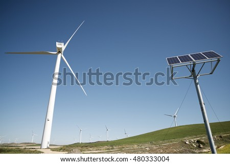 Windmills and photovoltaic panel for energy production, Zaragoza Province, Aragon, Spain.