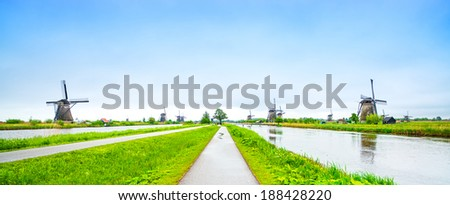 Windmills and water canal in Kinderdijk, Holland or Netherlands, panoramic view. Unesco world heritage site. Europe. - stock photo