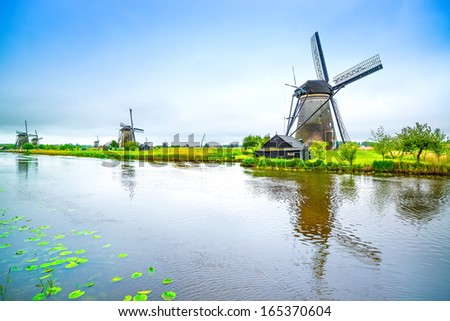 Windmills and water canal in Kinderdijk, Holland or Netherlands. Unesco world heritage site. Europe. - stock photo