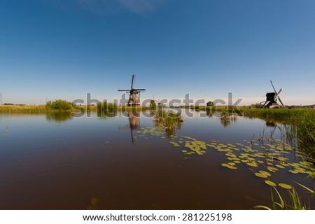 Windmills at Kinderdijk Holland - stock photo