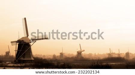 Windmills at sunset, Kinderdijk, Holland - stock photo