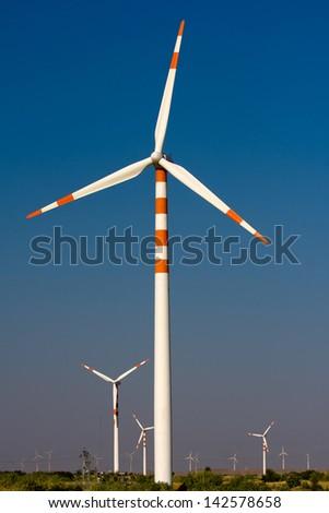Windmills at Thar desert in Rajasthan, India - stock photo