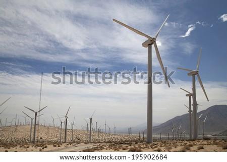 Windmills close and far, near Palm Springs CA - stock photo
