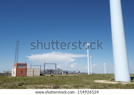 windmills for  electric power production and  electrical substation - stock photo