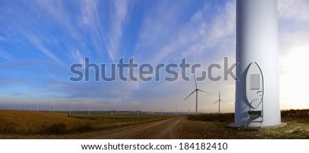 Windmills for electric power production at sunset, Pozuelo de Aragon, Zaragoza, Aragon, Spain - stock photo