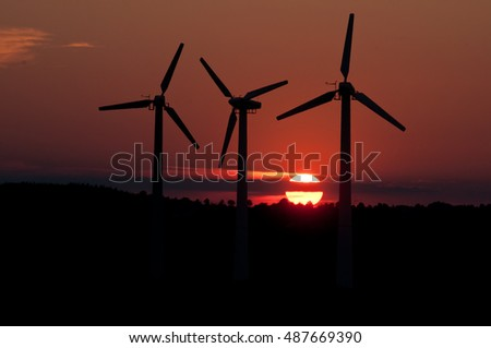 Windmills for electricin Poland with sun