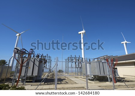 windmills for removable energy production and electrical substation, El Buste, Zaragoza, Aragon, Spain - stock photo