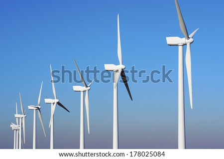 Windmills for renewable electric energy production, Pozuelo de Aragon, Zaragoza, Aragon, Spain - stock photo