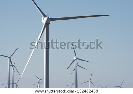 windmills for renowable electric production with clear sky