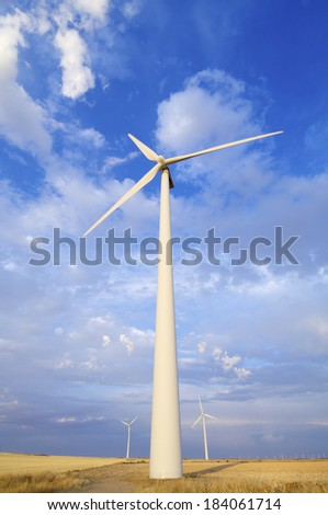 windmills group with cloudy sky at sunset  in Gurrea de Gallego, Huesca, Aragon, Spain - stock photo