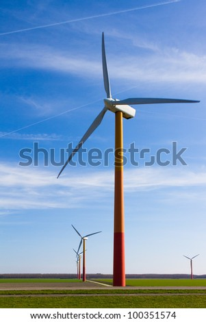 Windmills in a field with a blue sky