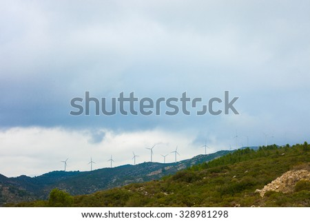 Windmills in eolic parc. Eolic energy. Color photography.  - stock photo