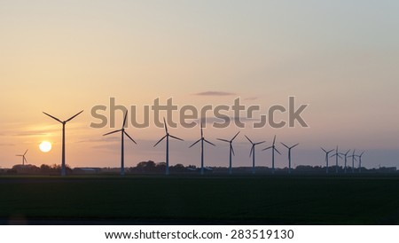 Windmills in sunset Netherlands