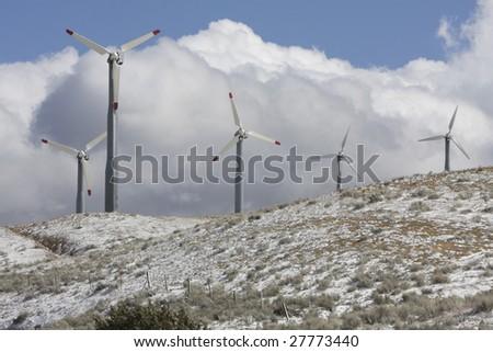 Windmills in the California hills. - stock photo