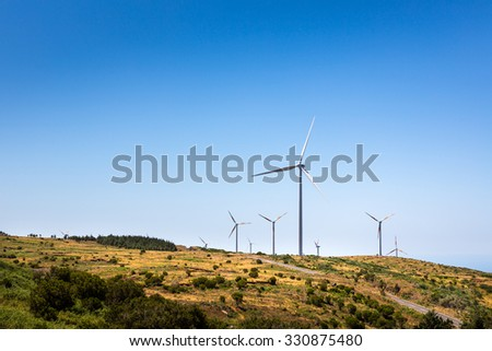 Windmills in the green valley on the hill