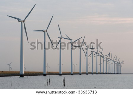 windmills in the sea - stock photo