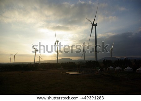 Windmills in the sunset background