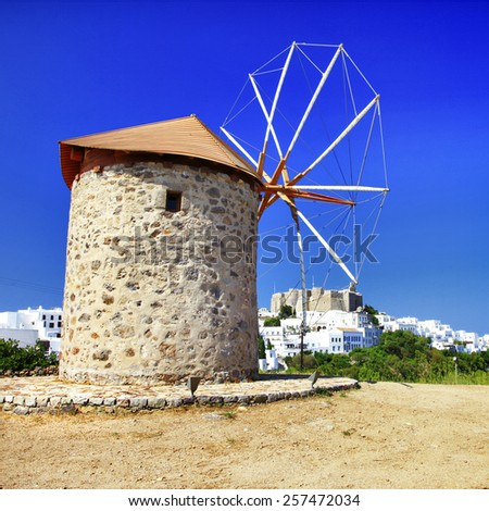 windmills of Greece - Patmos island, view with monastery - stock photo