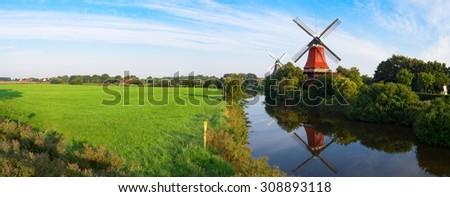 Windmills of Greetsiel in Germany - stock photo
