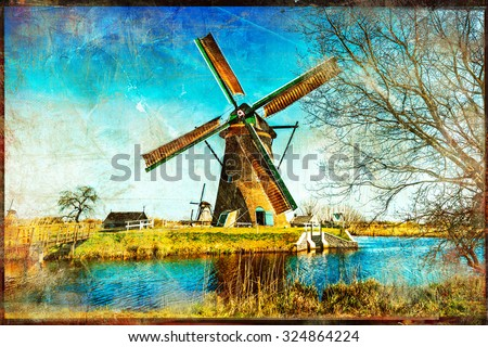 windmills of Holland - artwork in painting style - stock photo