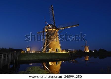 Windmills of Kinderdijk at night, the Netherlands. - stock photo