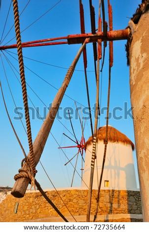 windmills of Mykonos island (Greece) at sunset - stock photo