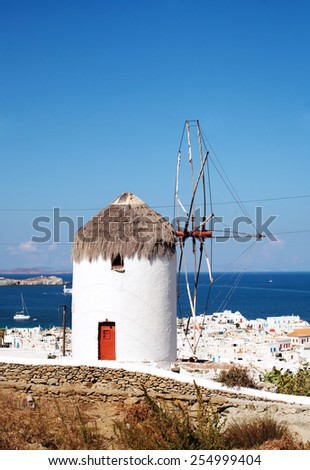Windmills of Mykonos overlooking the city, Greece. - stock photo