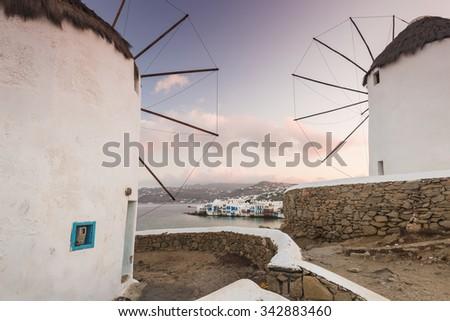 Windmills of Mykonos with a view of Little Venice. Mykonos, Greece - stock photo
