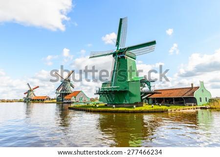 Windmills of Zaanse Schans, quiet village in Netherlands, province North Holland - stock photo