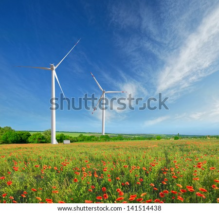 Windmills on a field in the early spring makovm - stock photo