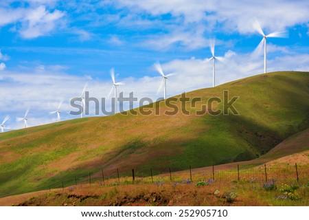 Windmills on a Green Hill - stock photo