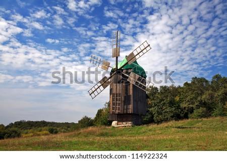 Windmills on blue sky - stock photo