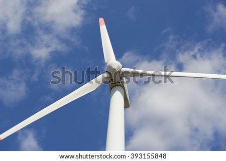 Windmills on blue sky background - stock photo