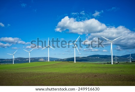 Windmills on green meadow. Cadiz, Spain